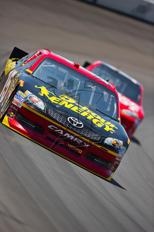 BROOKLYN, MI - JUN 14, 2012:  Clint Bowyer (15) brings his car through the turns during the second test session for the Quicken Loans 400 at the Michigan International Speedway in Brooklyn, MI.