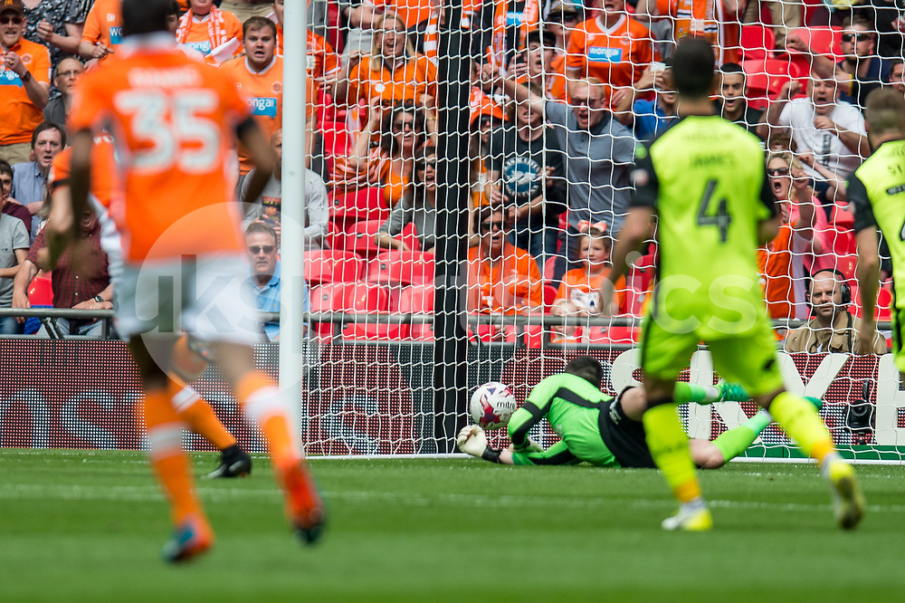 Brad Potts of Blackpool fires a shot past Christy Pym of Exeter City during the EFL Sky Bet League 2 Play-Off Final match between Blackpool and Exeter City at Wembley Stadium, London, England on 28 May 2017. Photo by Matthew Buchan.