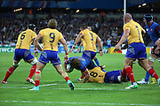 Dimitri Szarzweski (France's Captain) making a break for the Romanian try line but getting tackled by Mihai Macovei (Romania's captain) during the Rugby World Cup Pool D match between France and Romania at the Queen Elizabeth II Olympic Park, London, United Kingdom on 23 September 2015. Photo by Matthew Redman.