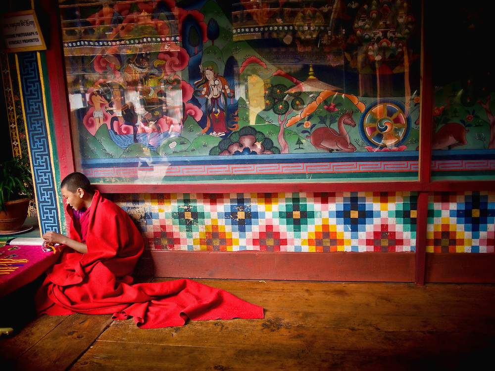 Asia, Bhutan, Paro, Dzong, young monk in warm light, colors, red
