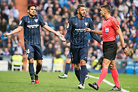 "Malaga CF's Weligton Robson and Jose Luis ""Recio"" Garcia talking with the referee during La Liga match between Real Madrid and Malaga CF at Santiago Bernabeu Stadium in Madrid, Spain. January 21, 2017. (ALTERPHOTOS/BorjaB.Hojas)"