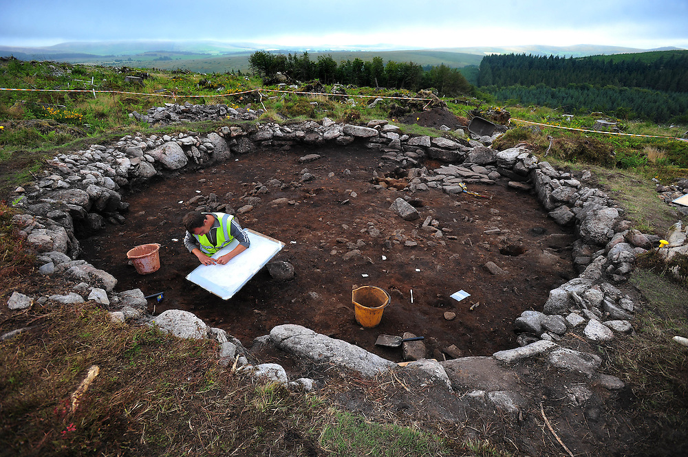 Picture By Jim Wileman  12/08/2009  The Archaeological roundhouse site at Bellever, Dartmoor, which is being surveyed by Dartmoor National Park. Project Officer Simon Hughes tracing the site plans.