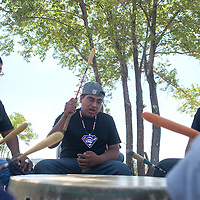 From left, Ronnie Soseeah, Lincoln Soseeah and Rodney Soseeah with the Midnight Thunder drum group perform a Honor Song during the groundbreaking ceremony on a new housing development in Zuni Wednesday.