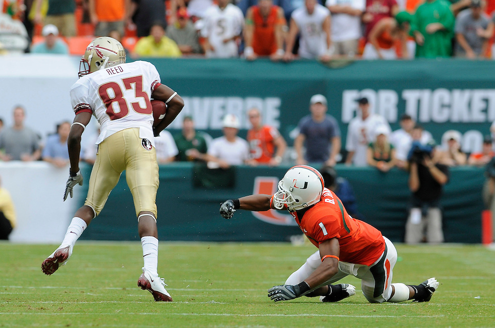 October 4, 2008 - Miami Gardens, FL<br /> <br /> Florida State University wide receiver Bert Reed jukes out University of Miami defensive back Brandon Harris during the Seminoles 41-39 victory over the Hurricanes at Dolphin Stadium in Miami Gardens, Florida.<br /> <br /> JC Ridley/CSM