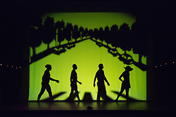 "© Licensed to London News Pictures. 12 March 2014. London, England. Pictured: Homage to London with the Beatles crossing the street at Abbey Road. Pilobolus dance troupe presents ""Shadowland"", a show part dance, part circus, part concert utilising multiple moving screens. ""Shadowland"" is performed for the first time in the UK. Created in collaboration with Steven Banks and featuring a score by David Poe, the show will run from 11 March to 30 March 2014 at the Peacock Theatre, London. Photo credit: Bettina Strenske/LNP"