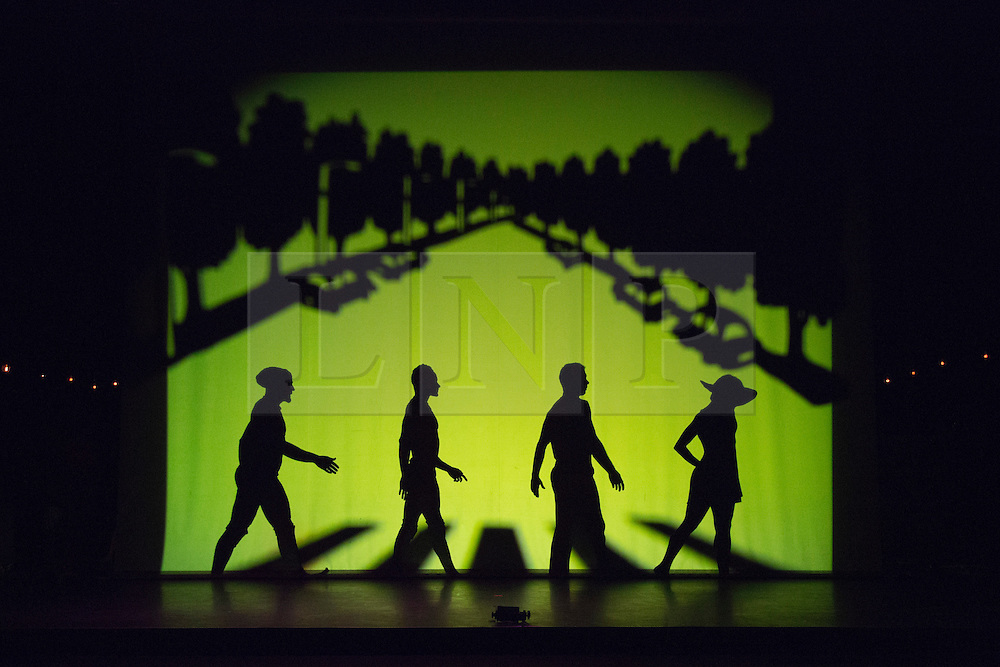 """© Licensed to London News Pictures. 12 March 2014. London, England. Pictured: Homage to London with the Beatles crossing the street at Abbey Road. Pilobolus dance troupe presents """"Shadowland"""", a show part dance, part circus, part concert utilising multiple moving screens. """"Shadowland"""" is performed for the first time in the UK. Created in collaboration with Steven Banks and featuring a score by David Poe, the show will run from 11 March to 30 March 2014 at the Peacock Theatre, London. Photo credit: Bettina Strenske/LNP"""