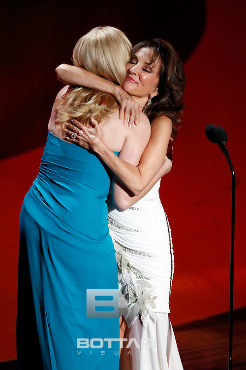 From left, Liza Huber and Susan Lucci embrace onstage during the Daytime Emmy Awards on Sunday June 19, 2011 in Las Vegas. (AP Photo/Jeff Bottari)