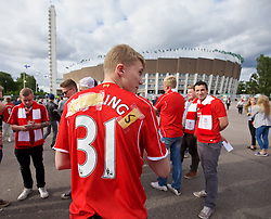 HELSINKI, FINLAND - Friday, July 31, 2015: A Liverpool supporter improvises a Danny Ings shirt from his Raheem Sterling name before a friendly match against HJK Helsinki at the Olympic Stadium. (Pic by David Rawcliffe/Propaganda)