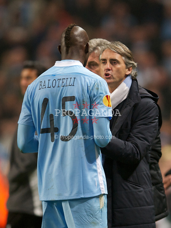 MANCHESTER, ENGLAND - Thursday, March 15, 2012: Manchester City's manager Roberto Mancini and Mario Balotelli during the UEFA Europa League Round of 16 2nd Leg match against Sporting Clube de Portugal at City of Manchester Stadium. (Pic by David Rawcliffe/Propaganda)