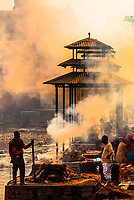 Funeral pyres are tended for many hours until cremated corpses are turned to ash,  Pashupatinath Temple, a Hindu temple along the Bagmati River in Kathmandu, Nepal. The Bagmati is equally as sacred to Nepalese as the Ganges is to Indians. Hindus come to be cremated here.