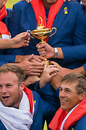 The trophy with the European teams hands on it<br /> <br /> The victorious European Team after beating USA with the trophy after the winning presentation<br /> <br /> Captain Thomas Bjorn<br /> Francesco Molinari&nbsp;<br /> Tommy Fleetwood&nbsp;<br /> Tyrrell Hatton&nbsp;&nbsp;&nbsp;&nbsp;&nbsp;&nbsp;&nbsp;&nbsp;&nbsp;&nbsp;&nbsp;&nbsp;&nbsp;&nbsp;&nbsp;&nbsp;&nbsp; <br /> Paul Casey&nbsp;&nbsp;&nbsp;&nbsp;&nbsp;&nbsp;&nbsp;&nbsp;&nbsp;&nbsp;&nbsp;&nbsp;&nbsp;&nbsp;&nbsp;&nbsp;&nbsp;&nbsp;&nbsp; <br /> Thorbjorn Olesen&nbsp;&nbsp;&nbsp;&nbsp;&nbsp;&nbsp;&nbsp;&nbsp;&nbsp;&nbsp;&nbsp;<br /> Rory McIlroy&nbsp;&nbsp;&nbsp;&nbsp;&nbsp;<br /> Jon Rahm&nbsp;&nbsp;&nbsp;&nbsp;&nbsp;&nbsp;&nbsp;&nbsp;&nbsp;&nbsp;&nbsp;&nbsp;&nbsp;&nbsp;&nbsp;&nbsp;&nbsp;&nbsp;&nbsp;&nbsp;&nbsp;&nbsp;&nbsp;&nbsp; <br /> Justin Rose&nbsp;&nbsp;&nbsp;<br /> Alex Noren<br /> Henrik Stenson<br /> Sergio Garc&iacute;a<br /> Ian Poulter<br /> Sunday singles<br /> The 42nd Ryder Cup Matches 2018 on the Albatros Course of Le Golf National, Paris, France. 30th September 2018