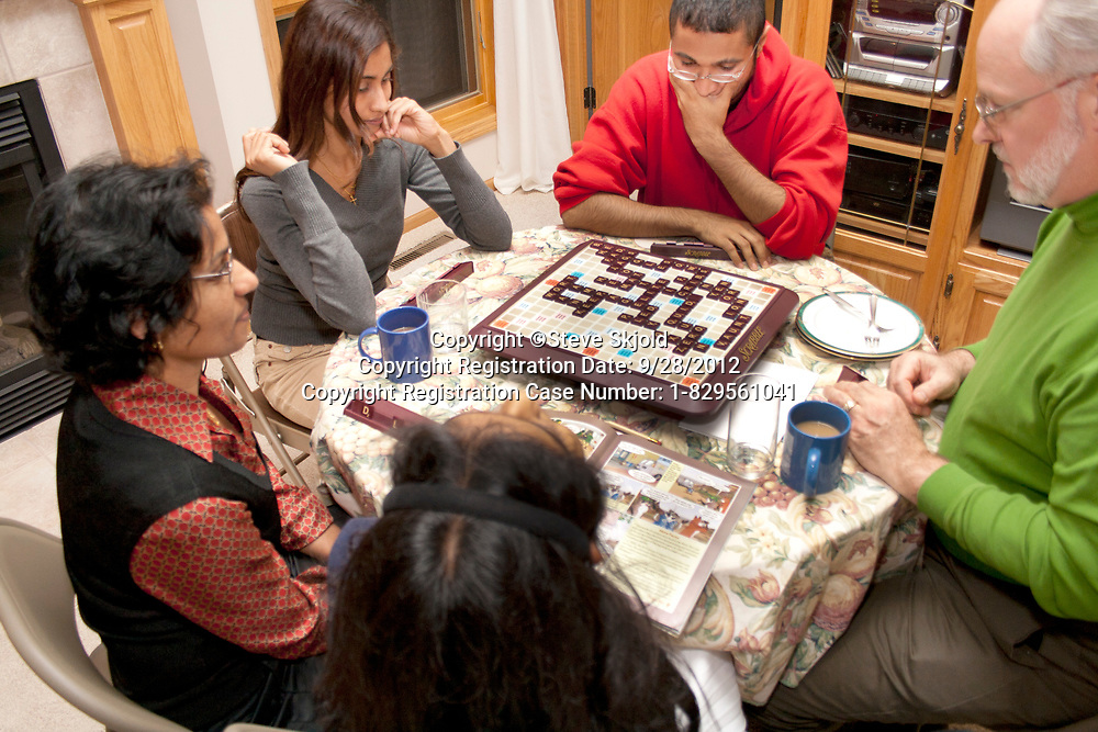 Intense family of American Scrabble players of white and East Indian heritage. Champlin Minnesota MN USA