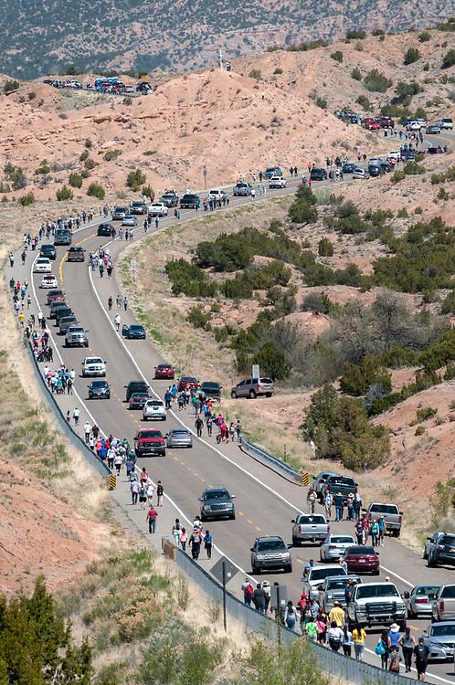 em041417i/a/Thousands walk along Juan Medina Road on thier way to the Santuario de Chimayo, Friday April 14, 2017. With beautiful weather, huge numbers of people were making the Good Friday pilgrimage to the Northern New Mexico church.  (Eddie Moore/Albuquerque Journal