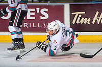 KELOWNA, CANADA - APRIL 23: Riley Stadel #3 of Kelowna Rockets keeps his stick on the puck as he falls to the ice against the Seattle Thunderbirds on April 23, 2016 at Prospera Place in Kelowna, British Columbia, Canada.  (Photo by Marissa Baecker/Shoot the Breeze)  *** Local Caption *** Riley Stadel;