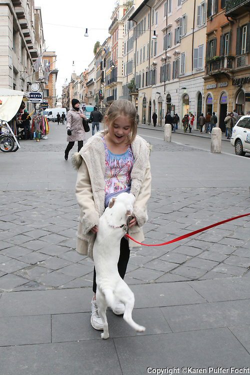Elli Rose Focht plays with a puppy in Rome, Italy.