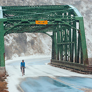 Heather Goodrich rides her roadbike along Highway 6 and the Eagle River near Eagle, Colorado.