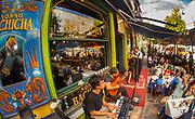 Tango dancers at streetside cafe, La Boca, Buenos Aires, Argentina.