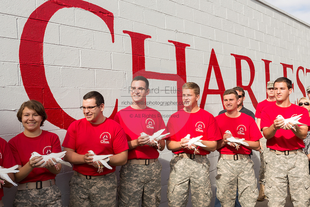 Citadel Military college cadets hold doves before the releasing them to inaugurate the Charleston Strong mural during ceremonies October 21, 2015 in Charleston, South Carolina. The wall is to commemorate the mass shooting at the historic Mother Emanuel African Methodist Episcopal Church last June.