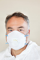Portrait of a male worker wearing a protective mask