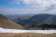 Stunning mountain range of Lake District National Park from western side of Helvellyn Mountain, Lake District, Cumbria, UK. It is a bright, sunny day, but there is snow on the ground along the mountain side. Helvellyn is the third-highest point in England and is located in the beautiful Lake District National Park and part of the Eastern Fells. (photo by Andrew Aitchison / In pictures via Getty Images)