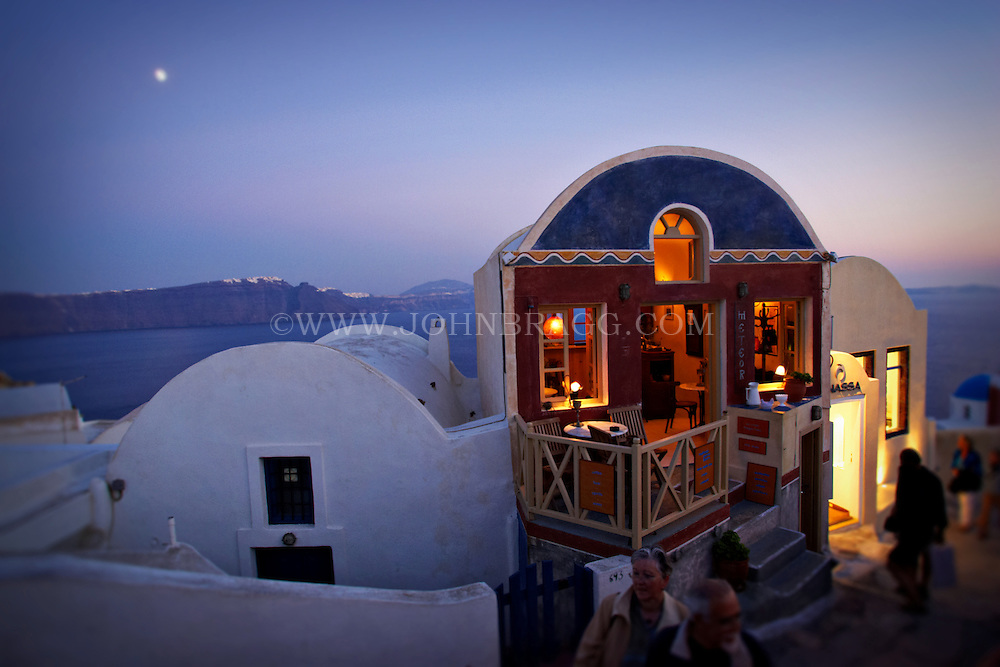 Unique homes at dusk in Santorini, Greece