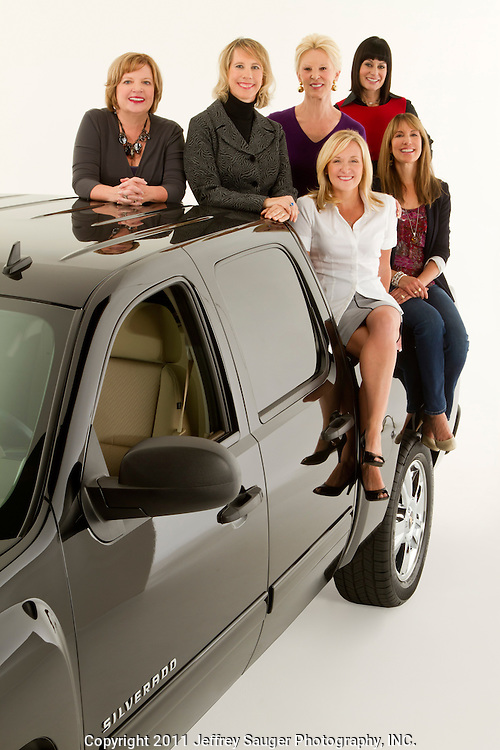 ROYAL OAK, MICHIGAN - OCTOBER 12: Clockwise from rear left: Candace Haag, Michelle Lange, Dannielle Hudler, Andrea Riley, Kathy Speck, and Kim Brink, pose with a Chevy Silverado pickup truck in Royal Oak, MI, Wednesday, October 12, 2011. (Jeffrey Sauger)