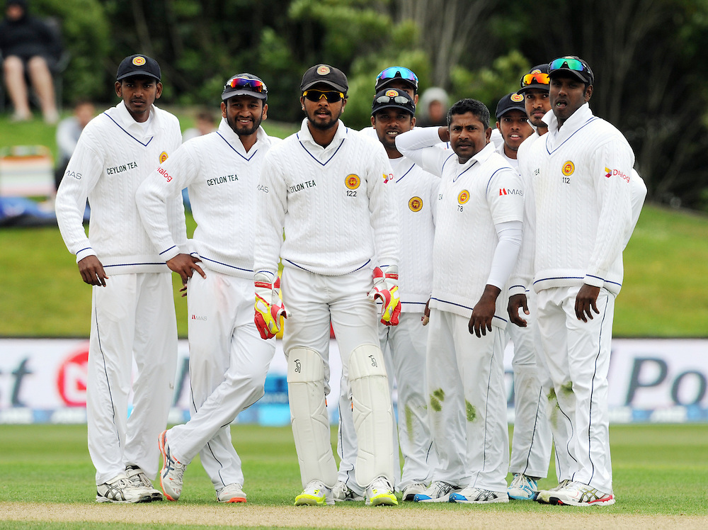 Sri Lanka watch the big screen after Rangara Herath, 2nd from right dismissed New Zealand's Martin Guptill for 46 on day three of the first International Cricket Test, University Cricket Oval, Dunedin, New Zealand, Saturday, December 12, 2015. Credit:SNPA / Ross Setford