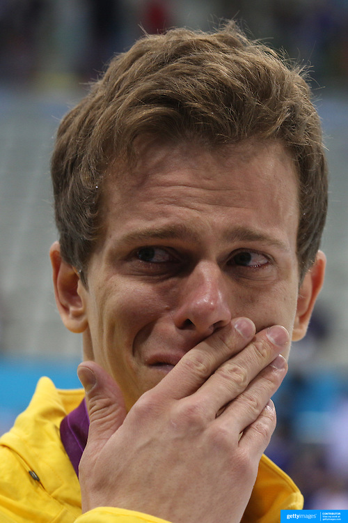 Cesar Cielo, Brazil, crying after his bronze medal presentation  in the 50m Freestyle Final at the Aquatic Centre at Olympic Park,  during the London 2012 Olympic games. London, UK. 3rd August 2012. Photo Tim Clayton