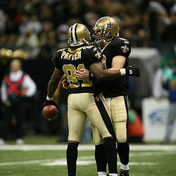 2007 December, 16: New Orleans Saints quarterback Drew Brees (9) celebrates with teammate wide receiver David Patten (81)during a 31-24 win by the New Orleans Saints over the Arizona Cardinals at the Louisiana Superdome in New Orleans, LA.