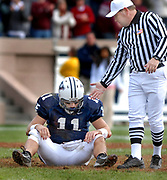 NE11/17/07 1Yale<br /> ML0408C<br /> Yale Bowl, game with Harvard, 2nd quarter: A game referee lends a hand to a dejected Yale quarterback Matt Polhemus after yet another turnover to Harvard. Photo by Mara Lavitt