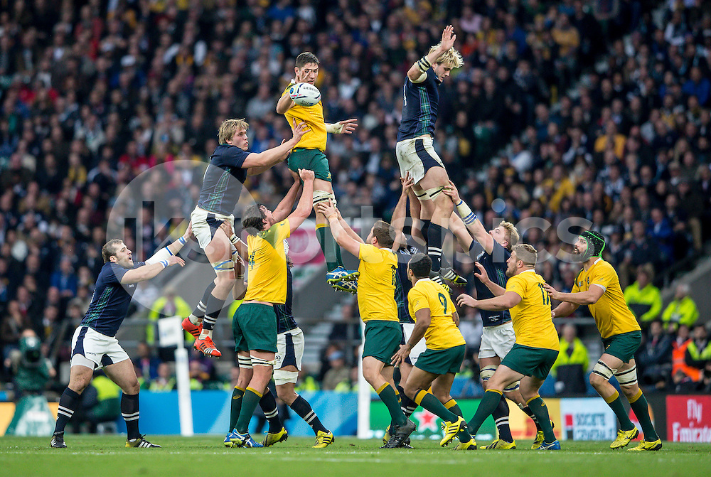 Rob Simmons of Australia collects and feeds Will Genia of Australia during the Rugby World Cup Quarter Final match between Australia and Scotland played at Twickenham Stadium, London on the 18th of October 2015. Photo by Liam McAvoy.