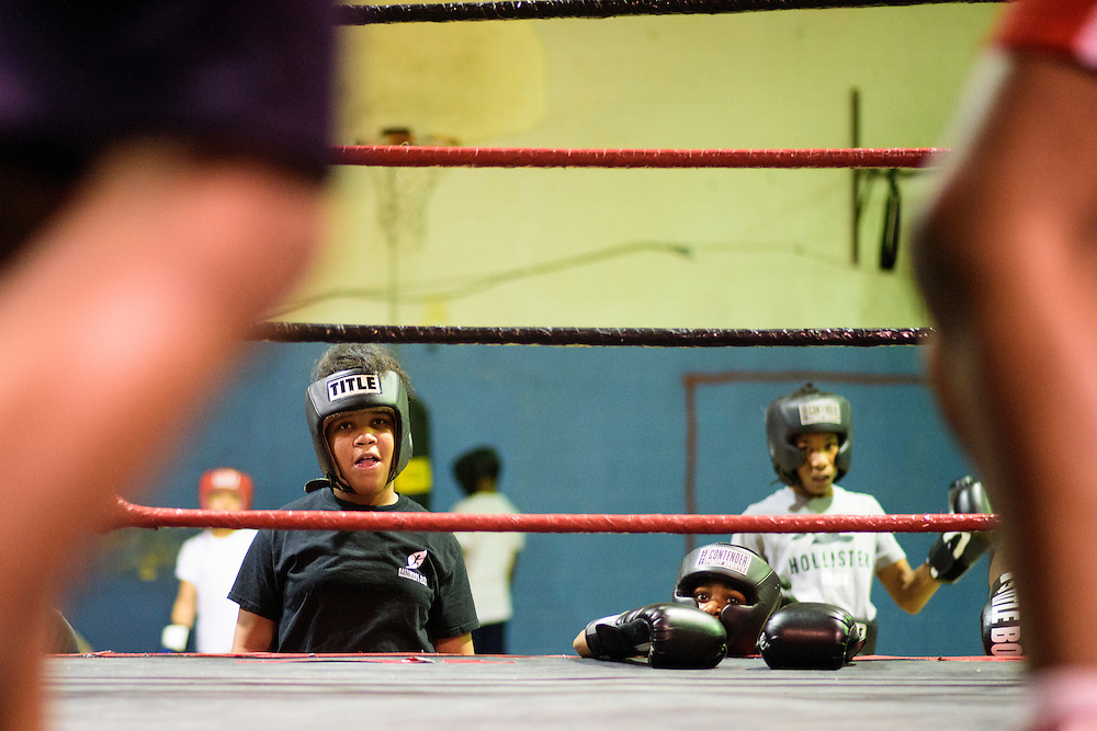 Baltimore, Maryland - January 26, 2017: Kyerianna &quot;lil mama&quot; Foro, 11, left, watches a sparring match at the Upton Boxing Club in Baltimore Thursday January 26, 2017.<br /> <br /> <br /> CREDIT: Matt Roth for The New York Times<br /> Assignment ID: