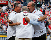 ATLANTA, GA - OCTOBER 2:  Former Atlanta Braves manager Bobby Cox embraces former pitchers Greg Maddux and John Smoltz while Tom Glavine looks on during pre-game ceremonies to honor the last game at Turner Field during the game between the Detroit Tigers and the Atlanta Braves on Sunday, October 2, 2016 in Atlanta, Georgia. (Photo by Mike Zarrilli/MLB Photos via Getty Images) *** Local Caption ***
