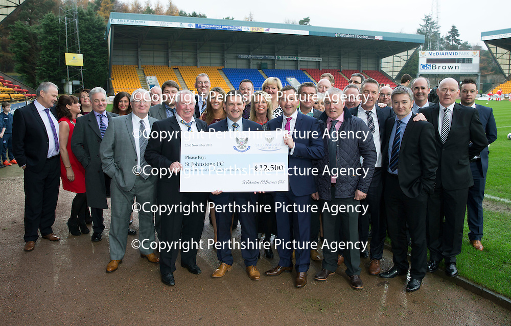 St Johnstone v Ross County....22.11.14   SPFL<br /> Chairman Steve Brown pictured receiving a cheque for £12,500 from Derek Petterson of the St Johnstone FC Business Club..<br /> Picture by Graeme Hart.<br /> Copyright Perthshire Picture Agency<br /> Tel: 01738 623350  Mobile: 07990 594431
