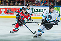 KELOWNA, CANADA - DECEMBER 2: Kyle Topping #24 of the Kelowna Rockets skates beside Jeff De Wit #11 of the Kootenay Ice on December 2, 2017 at Prospera Place in Kelowna, British Columbia, Canada.  (Photo by Marissa Baecker/Shoot the Breeze)  *** Local Caption ***