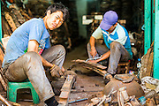 26 APRIL 2013 - BANGKOK, THAILAND:    A man uses a sledgehammer to make truck springs in Talat Noi. The Talat Noi neighborhood in Bangkok started as a blacksmith's quarter. As cars and buses replaced horse and buggy, the blacksmiths became mechanics and now the area is lined with car mechanics' shops. It is one the last neighborhoods in Bangkok that still has some original shophouses and pre World War II architecture. It is also home to a  Teo Chew Chinese emigrant community.      PHOTO BY JACK KURTZ