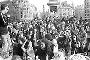 Crowd of dancing protesters, 1st Criminal Justice March, Trafalgar Square, London, UK, 1st of May 1994.