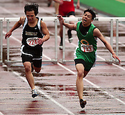 05/13/2009 -  Cleveland's Howard Lao (133) leans across the finish line ahead of Phomvongkoth  (224) during the men's 300 meter hurdles. The 5A PIL Varsity District Track Meet takes place at Lewis and Clark College....KEYWORDS:  City, Portland, high school, girls, boys, run, field, sports