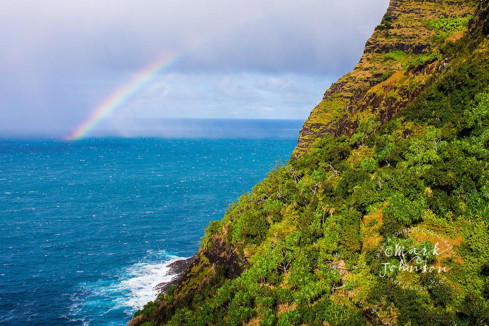 A rainbow off the Na Pali Coast, Kauai, Hawaii