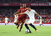 SEVILLE, SPAIN - AUGUST 10:   Sergio Escudero of Sevilla FC (R) competes for the ball with Bruno Peres of AS Roma (L) during a Pre Season Friendly match between Sevilla FC and AS Roma at Estadio Ramon Sanchez Pizjuan on August 10, 2017 in Seville, Spain. (Photo by Aitor Alcalde/Getty Images)