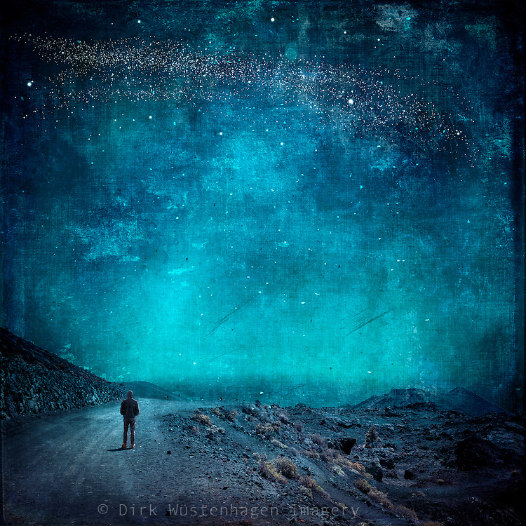 Surreal landscape with s man standing on a road - manipulated photograph