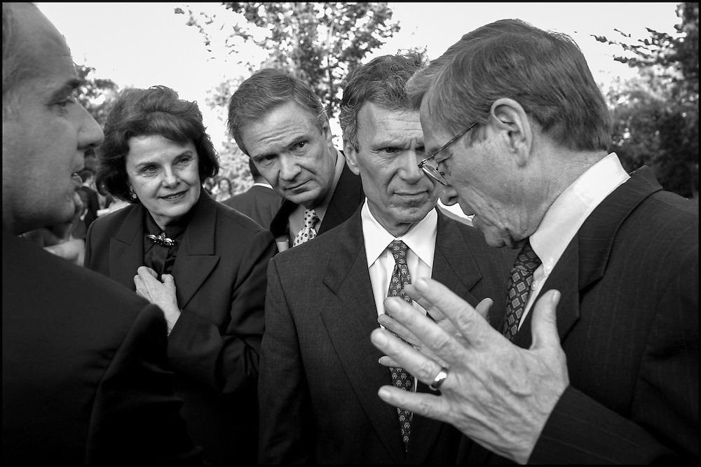 The debate goes on outdoors during a bomb scare at the Captiol:  Daschle, Broaux, Feinstein and Toricelli listen to Domenici outside the Capitol during an evacuation of the building.  9/13/01