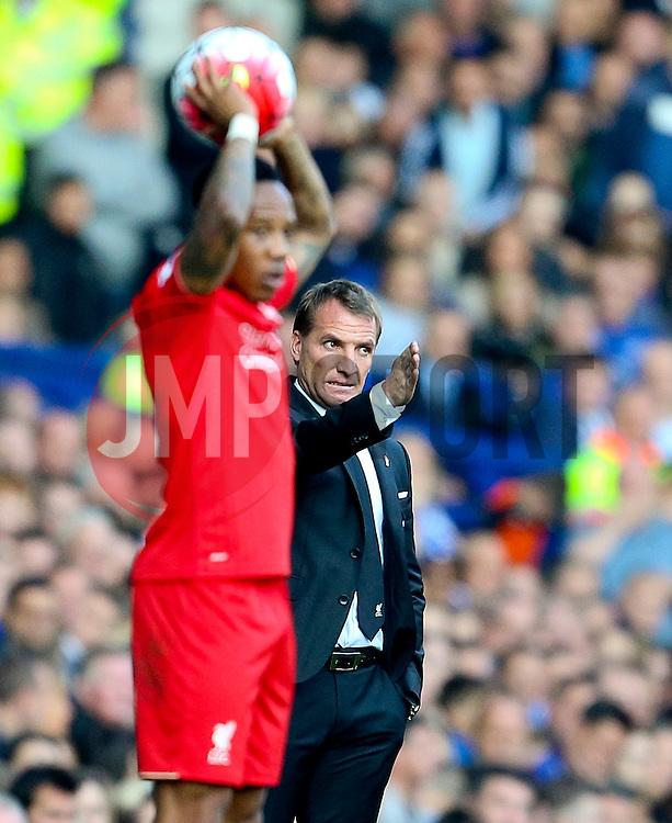 Liverpool Manager, Brendan Rodgers gestures instructions behind Nathaniel Clyne  - Mandatory byline: Matt McNulty/JMP - 07966 386802 - 04/10/2015 - FOOTBALL - Goodison Park - Liverpool, England - Everton  v Liverpool - Barclays Premier League