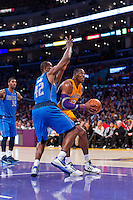 30 October 2012: Center (12) Dwight Howard of the Los Angeles Lakers drives to the basket while being guarded by (42) Elton Brand of the Dallas Mavericks during the second half of the Mavericks 99-91 victory over the Lakers at the STAPLES Center in Los Angeles, CA.