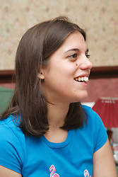 Young white student in discussion group at home.