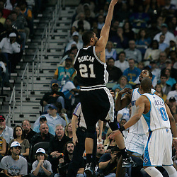 29 March 2009: San Antonio Spurs center Tim Duncan (21) shoots over New Orleans Hornets defenders Hilton Armstrong (12) and Antonio Daniels (50)during a NBA game between Southwestern Conference rivals the New Orleans Hornets and the San Antonio Spurs at the New Orleans Arena in New Orleans, Louisiana.