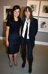Left to right, ALISON JACQUES and rock star PATTI SMITH at an exhibition of photographs by the late Robert Mapplethorpe at the Alison Jacques Gallery, 4 Clifford Street, London W1 on 7th September 2006.<br /><br />NON EXCLUSIVE - WORLD RIGHTS