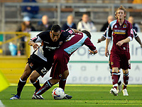 Photo: Jed Wee.<br />Burnley v Hull. Coca Cola Championship. 14/10/2006.<br /><br />Hull's Craig Fagan (L) tries to wrestle free of Burnley's Andy Dawson.