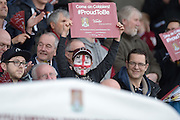 A young face painted Cobblers fan during the Sky Bet League 2 match between Northampton Town and Cambridge United at Sixfields Stadium, Northampton, England on 12 March 2016. Photo by Dennis Goodwin.