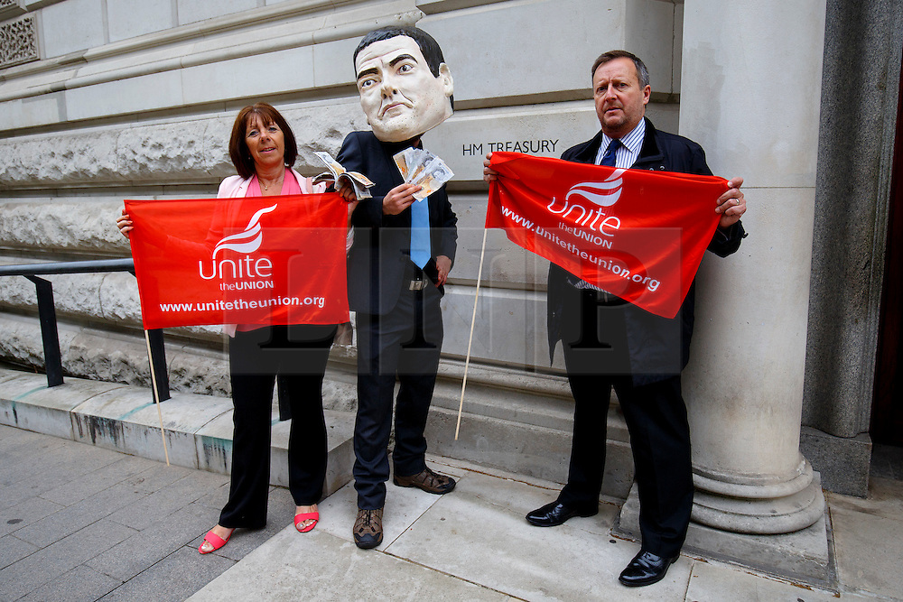 © Licensed to London News Pictures. 12/08/2015. London, UK. Demonstrators protest against the government's RBS shares sell-off outside HM Treasury in London on Wednesday, August 12, 2015 as 'Move Your Money' campaign group delivers  a petition signed by 118,000 to HM Treasury. Photo credit: Tolga Akmen/LNP